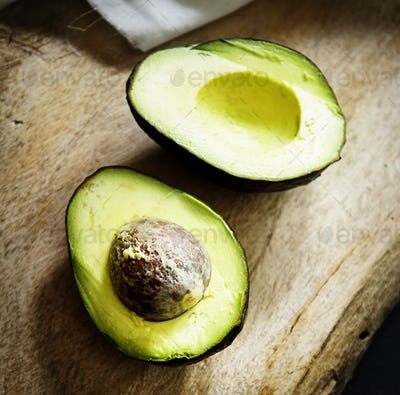 Aerial view of fresh avocado on wooden background