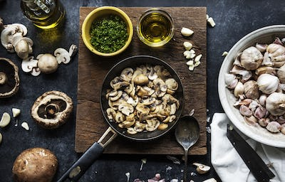 Aerial view of cooked mushroom in pan on wooden background