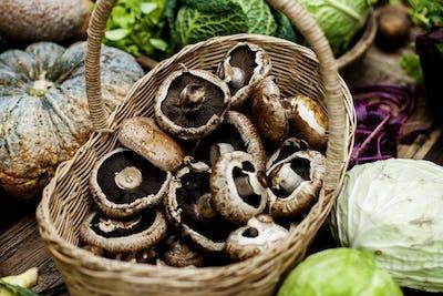 Closeup of fresh bunch of portobello mushroom in wooden basket