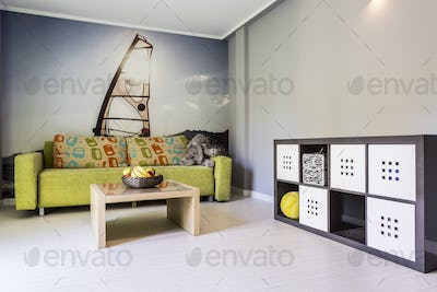 White room with photo wallpaper with windsurfing