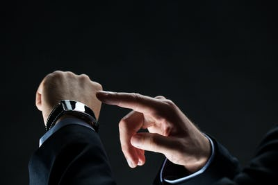 close up of businessman hands with smart watch