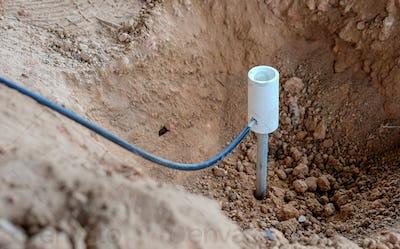 Welding copper ground wire on ground rod.