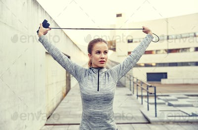 woman exercising with jump-rope outdoors