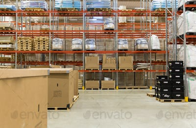 cargo boxes storing at warehouse shelves
