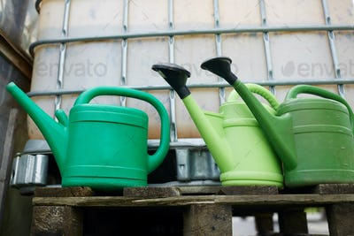 watering cans at farm water tank