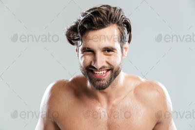Happy man standing isolated over grey background