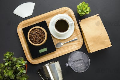 Roasted Beans On Weight Scale With Coffee Cup In Tray
