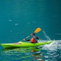 Caucasian Kayaker on the Lake