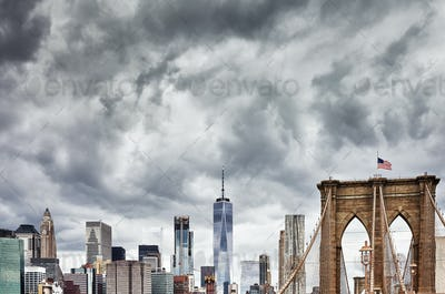 Stormy clouds over Manhattan and Brooklyn Bridge, NYC.