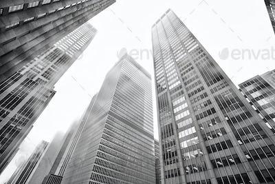 Manhattan skyscrapers in rainy fog, NYC, USA.