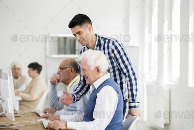 Man checking senior's progress