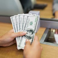 hands with money at bank office or exchanger