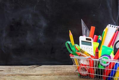 School shopping basket on blackboard background