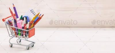 School shopping cart on white background