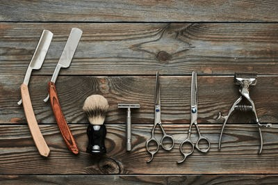 Vintage barber shop tools on wooden background