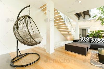 Modern armchair in spacious living room