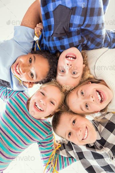 Children touching their heads