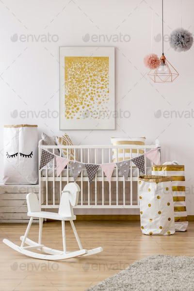 Modern newborn corner with golden decor