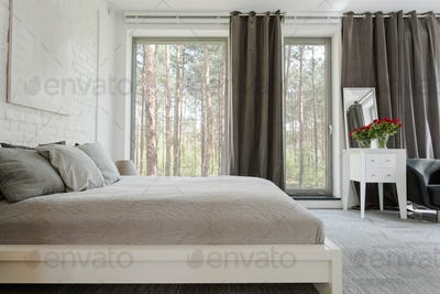 Comfortable king-size bed in a spacious bedroom