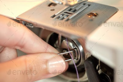 tailor hand setting spool to sewing machine