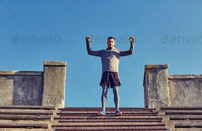 happy man on stadium stair