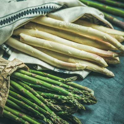 Fresh green and white asparagus in towel, square crop