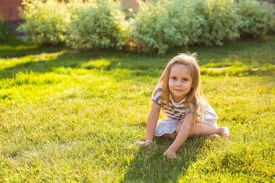 Sweet little girl play outdoors