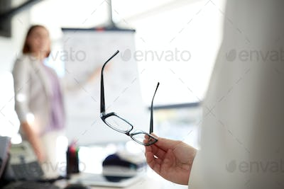 businessman with glasses at presentation in office