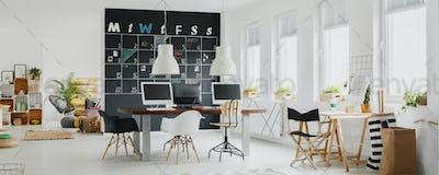 Modern office with blackboard