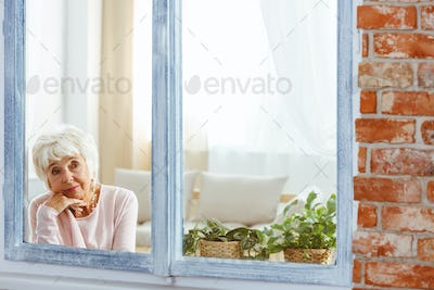 Woman lost in thought by the window