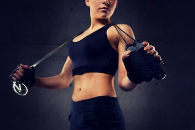 close up of sporty woman with jumping rope