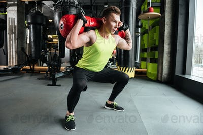 Young concentrated sportsman make sport exercises