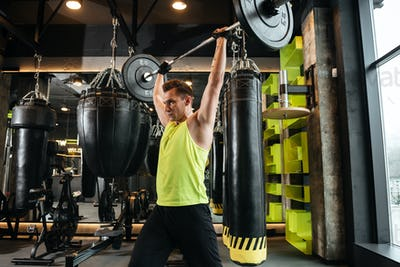 Serious sportsman make sport exercises in gym