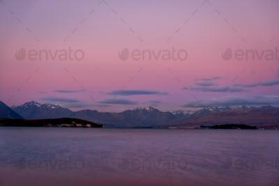 Colorful dreamy landscape of Lake Tekapo at sunset, New Zealand