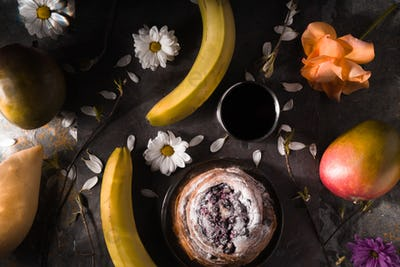 Tea party still ife with fruits and flowers