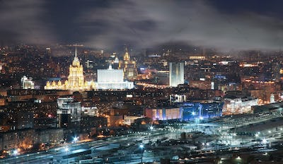 View from the roof tops in the winter on night city Moscow