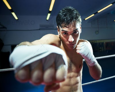 Young Man Training Boxe On Ring Of Boxing Gym