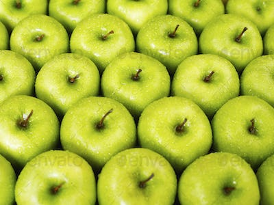 Closeup Of Green Apples In A Row