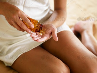 Young Woman Taking Medicine Pills