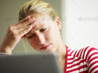 Young Woman Feeling Headache Looking At Computer Laptop Monitor