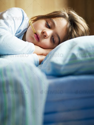Young Girl Feeling Sick Measuring Fever With Thermometer