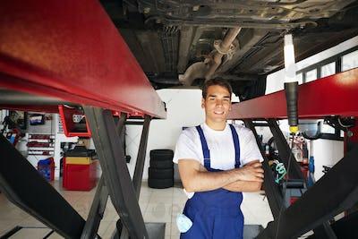 Portrait Of Man Working As Mechanic Repairing Car