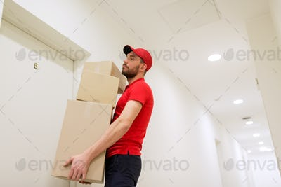delivery man with parcel boxes at customer door