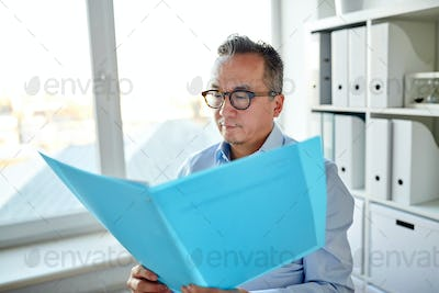 businessman with folder and papers at office