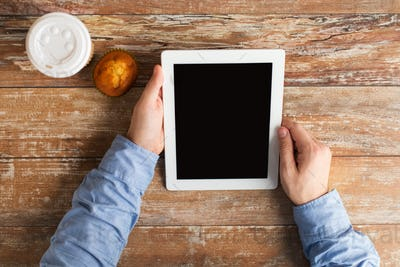 businessman hands with tablet pc and coffee