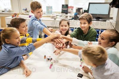 happy children holding hands at robotics school