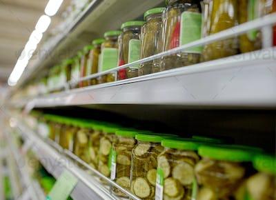 jars of pickles on grocery or supermarket shelves