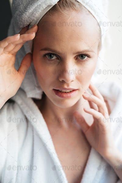Portrait of beautiful blonde woman looking camera