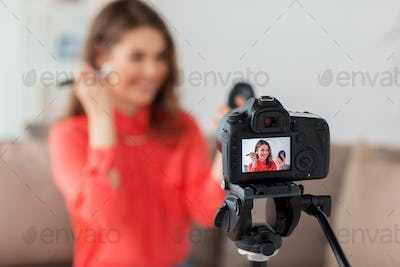 woman with bronzer and camera recording video