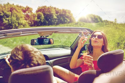friends driving in car and blowing bubbles